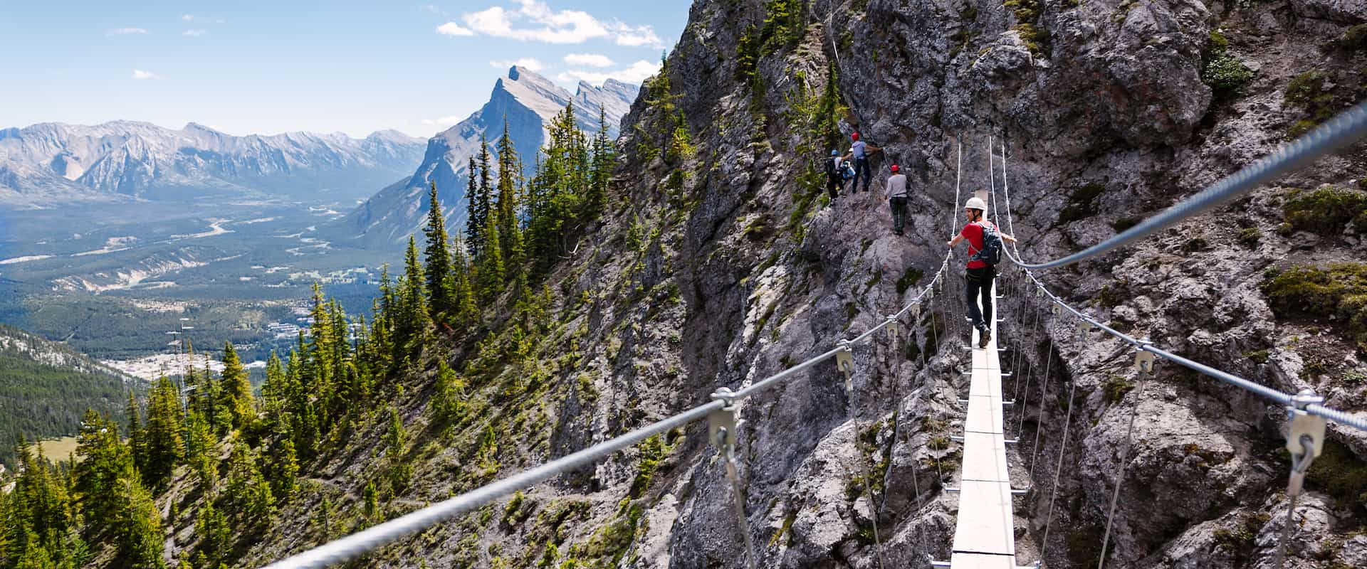 Cross a suspension bridge on the Mount Norquay Via Ferrata Explorer Route