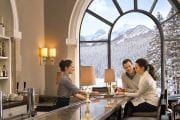 Enjoy a drink at the Lakeview Lounge at Lake Louise on the Discover Lake Louise winter tour with Discover Banff Tours in the Canadian Rockies