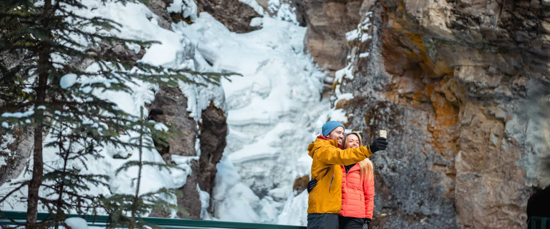 Photos at Johnston Canyon's lower falls on a guided icewalk with Discover Banff Tours