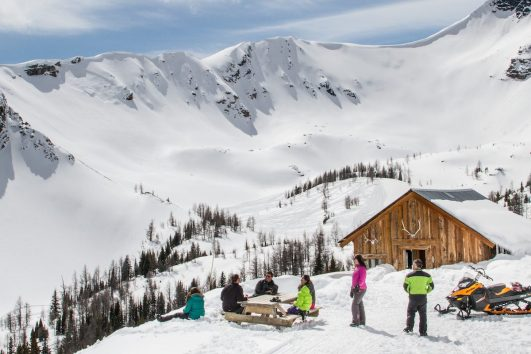 Relax at the Alpine Cabin on the Panorama Paradise Basin Snowmobiling Tour