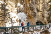 See Johnston Canyon's natural cave in winter on an icwealk with Discover Banff Tours