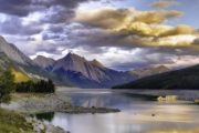 See Medicine Lake surrounded by mountains in Jasper National Park