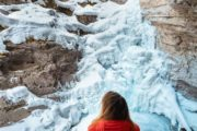 See the frozen lower falls at Johnston Canyon on a guided icewalk with Discover Banff Tours