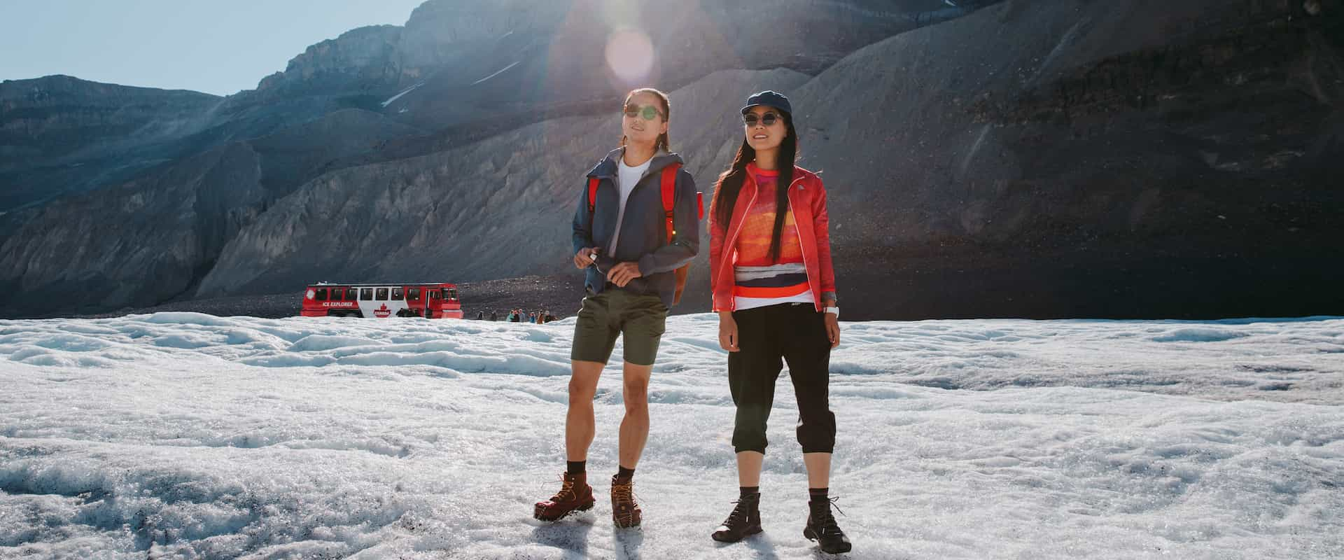 Stand on the ancient Athabasca Glacier on the Columbia Icefields Parkway Tour with Discover Banff Tours in the Canadian Rockies