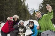 Take the whole family on a dogsled adventure at Spray Lakes near Canmore in the Canadian Rockies
