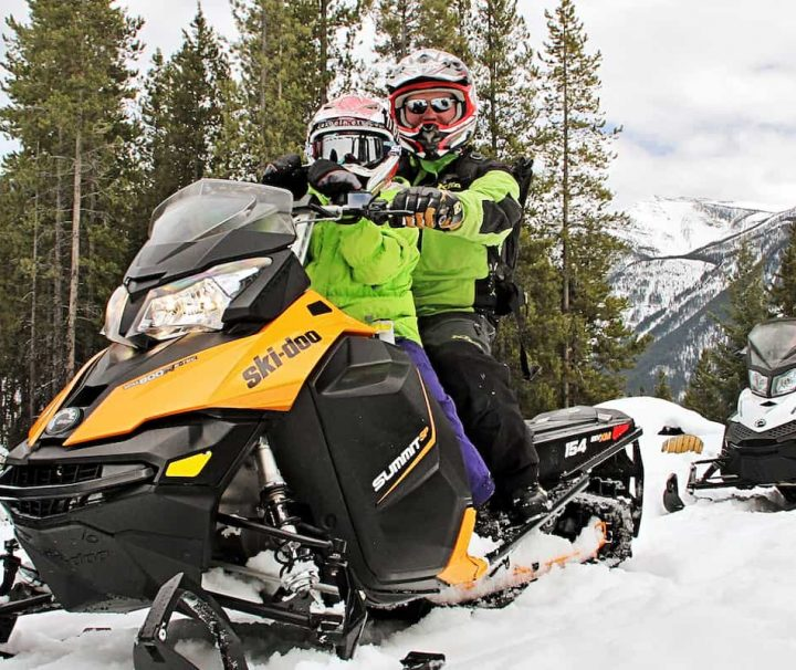Take the whole family on a full day snowmobiling tour in the Canadian Rockies