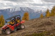 The whole family can fit in a four person side by side ATV in the Canadian Rockies