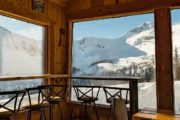 Warm up for lunch in the heated alpine cabin on the Paradise Basin snowmobiling tour in the Canadian Rockies