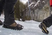 Wear comfortable ice cleats over your winter boots on the Grotto Canyon Icewalk with Discover Banff Tours in the Canadian Rockies