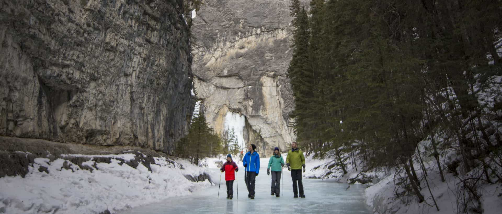 Wear ice cleats on a frozen creek bed on a Grotto Canyon Icewalk with Discover Banff Tours in the Canadian Rockies