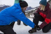 Your friendly guide will help you put on ice cleats for your winter icewalk