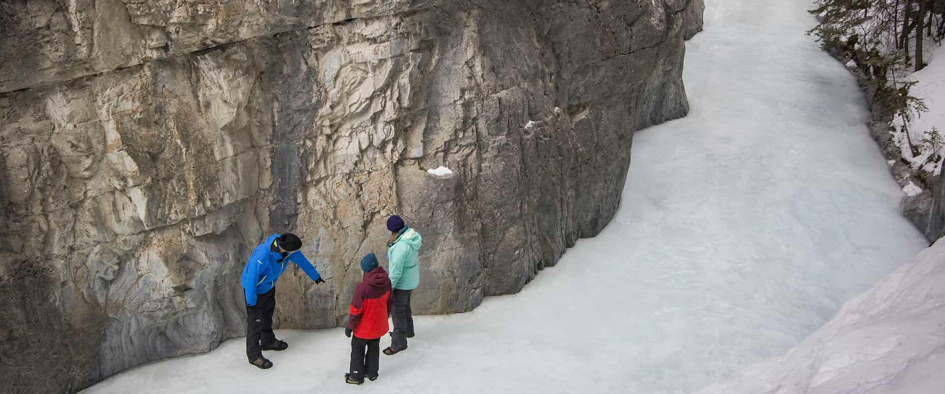 Your guide will point out ancient pictographs at Grotto Canyon on an icewalk with Discover Banff Tours