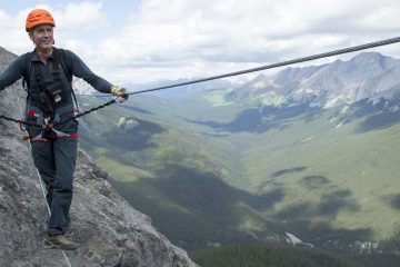 Cross an additional wire bridge on the Mount Norquay Via Ferrata Summiteer Route in Banff in the Canadian Rockies