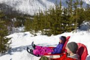 Sit at Marble Canyon's iconic red chairs on a snowshoeing tour with Discover Banff Tours