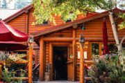 Dine in the log cabin ambiance of Baker Creek Bistro on the Deluxe Lake Louise Tour