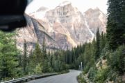 Drive along the road to Moraine Lake on the Deluxe Lake Louise Tour