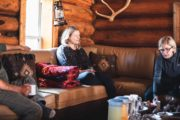 Relax in the lounge area of Halfway Lodge on a backcountry vacation