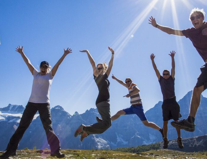 Group Jumping on a Guided Larch Valley Hike