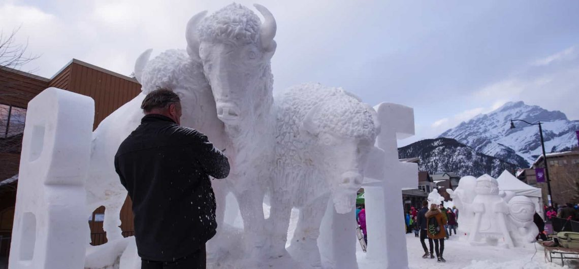 See snow sculptures during the SnowDays Festival in Banff