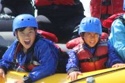 Children love rafting the Kananaskis River rapids in the Canadian Rockies
