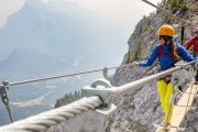 Cross a 55 metre suspension bridge on Mount Norquay's Via Ferrata Skyline Route in Banff in the Canadian Rockies