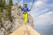 Cross a suspension bridge on Mount Norquay's Via Ferrata Skyline Route in Banff in the Canadian Rockies