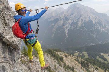 Cross a wire bridge on Mount Norquay's Via Ferrata Skyline Route in Banff in the Canadian Rockies