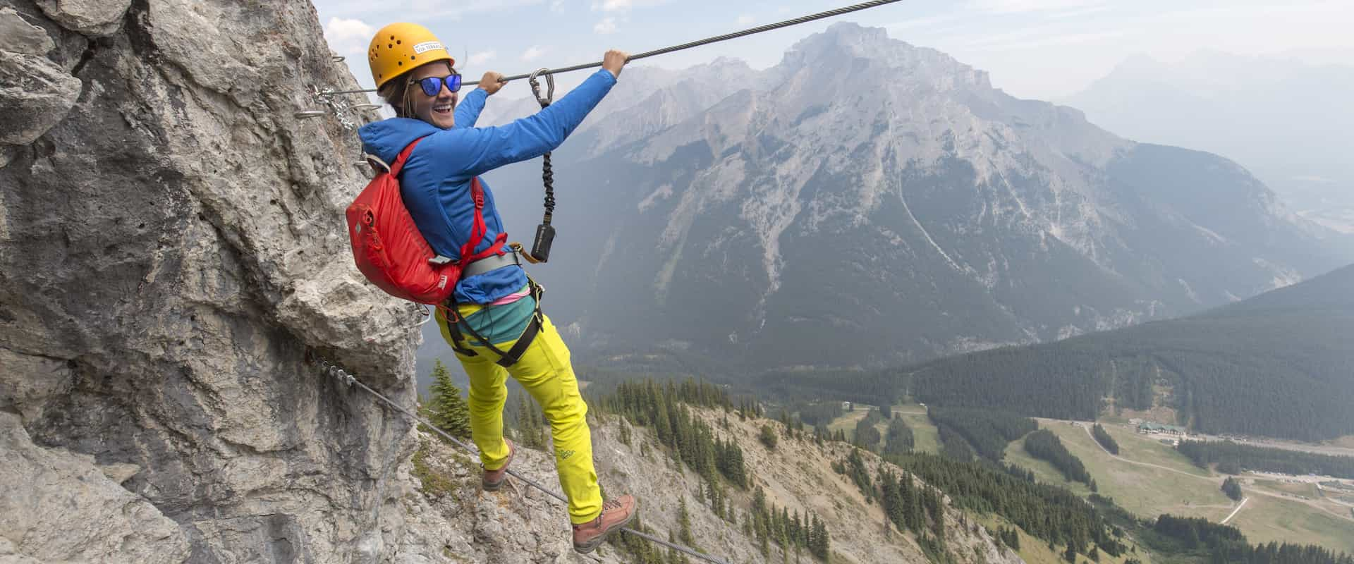 Cross a wire bridge on Mount Norquay's Via Ferrata Skyline Route in Banff in the Canadian Rockies