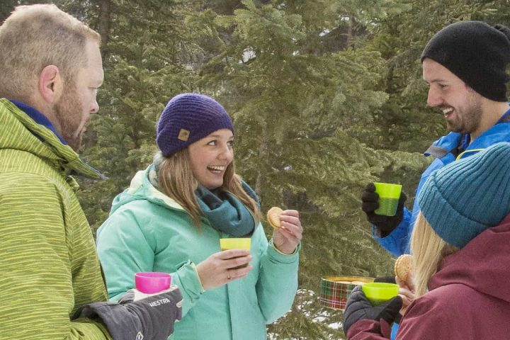 Enjoy hot chocolate and maple cookies on winter tours with Discover Banff Tours in the Canadian Rockies