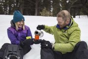 Enjoy hot chocolate on a winter snowshoeing tour with Discover Banff Tours in the Canadian Rockies