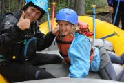 Learn how to raft with an instructional safety talk before the Kananaskis River in the Canadian Rockies