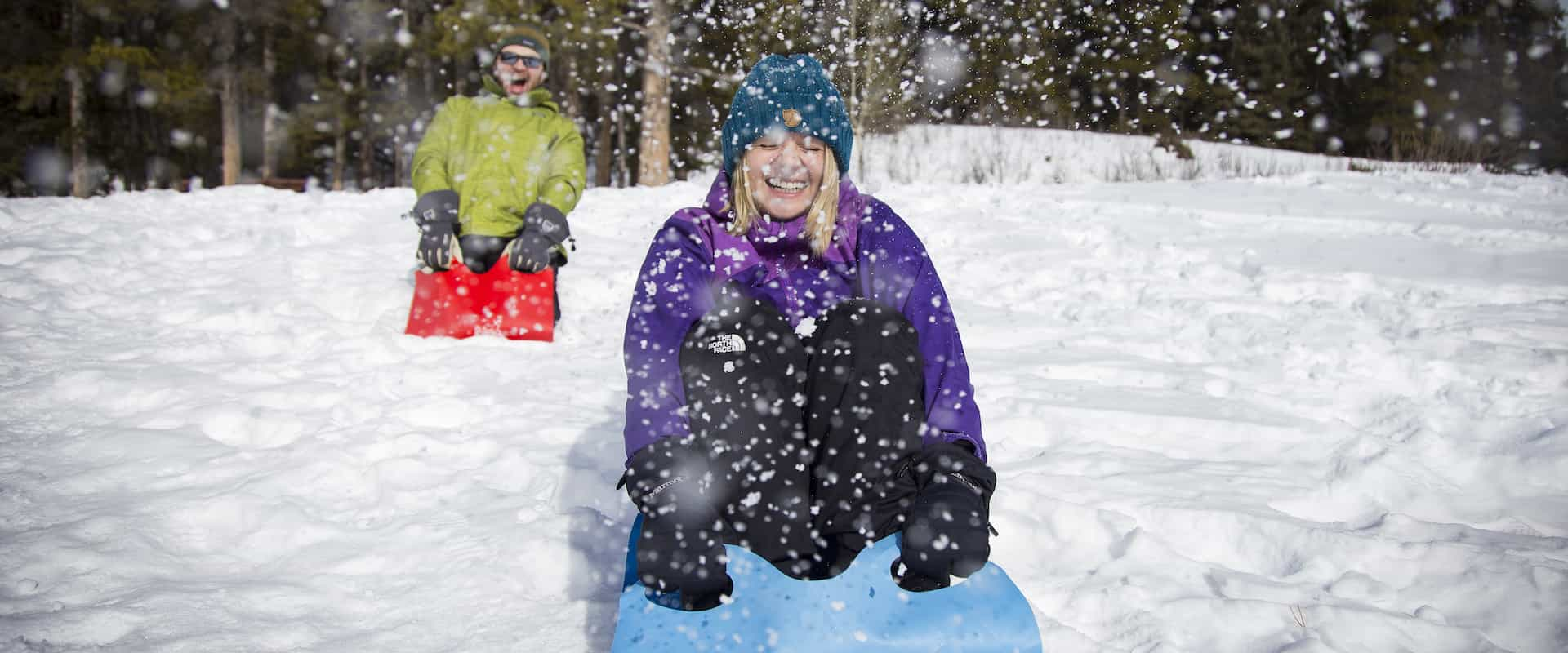 Take a crazy carpet slide on the Snowshoeing Tour to the Paint Pots with Discover Banff Tours to the Canadian Rockies