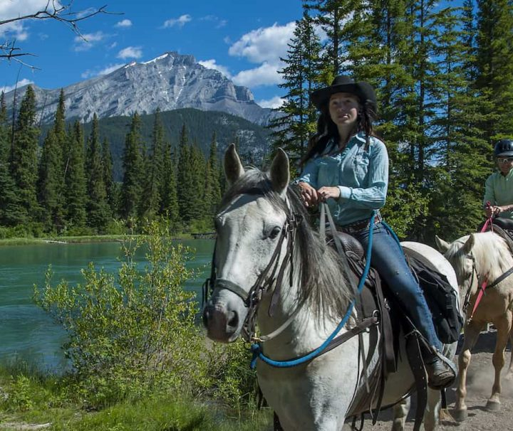 Take a guided horseback ride along the Bow River with Discover Banff Tours in the Canadian Rockies