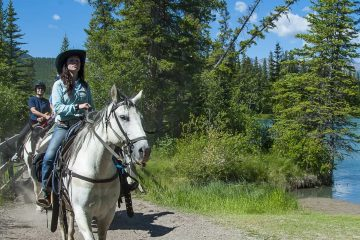 Take a scenic horseback ride along the Bow River with Discover Banff Tours in the Canadian Rockies