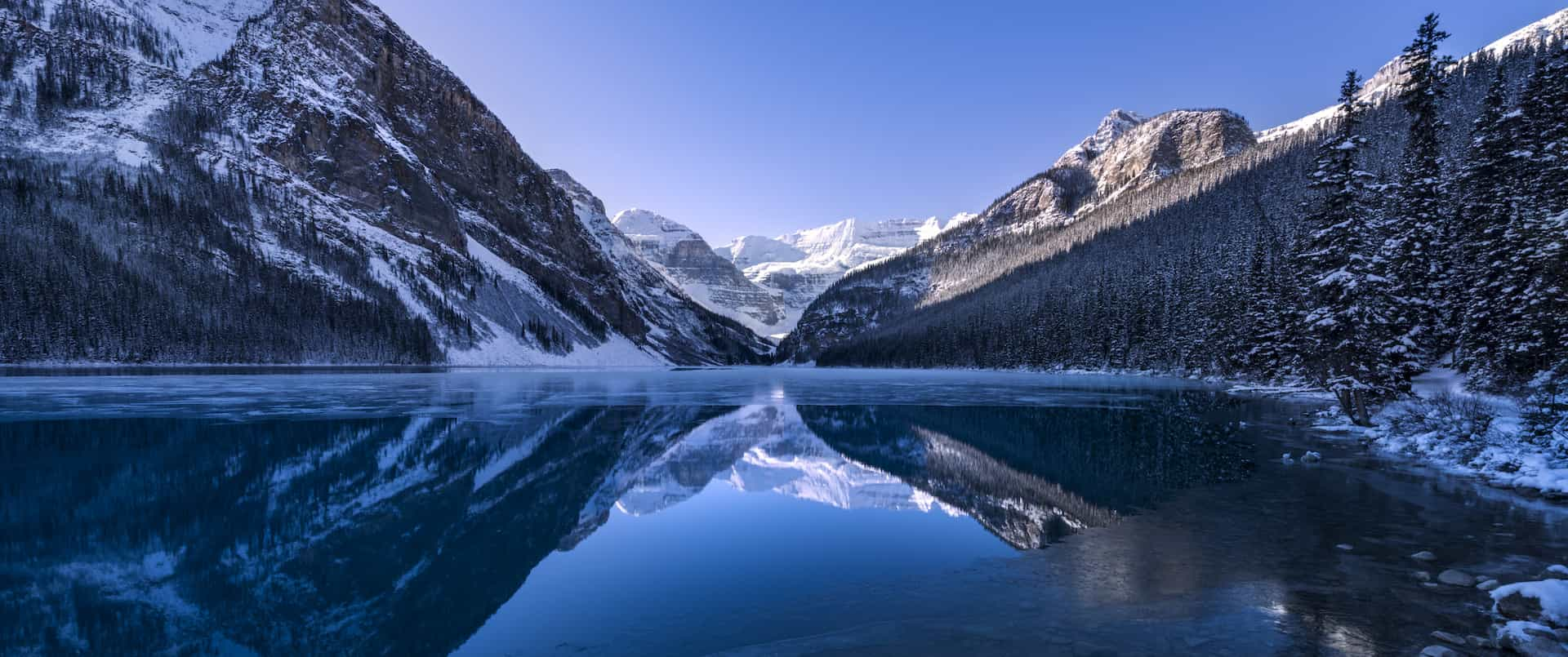 See Lake Louise surrounded by snow on the fall tour with Discover Banff Tours