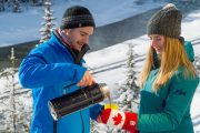 Our guide will pour you hot chocolate on the Discover Lake Louise winter tour with Discover Banff Tours in the Canadian Rockies
