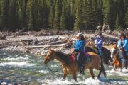 River crossing on the Sundance Overnight Lodge Horseback Trip