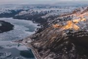 Fly over icy rivers and snowy mountains at Abraham Lake